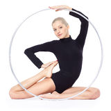 Blonde gymnast with hula hoop. Portrait of beautiful young blonde woman gymnast training calilisthenics exercise with hula hoop Royalty Free Stock Photo