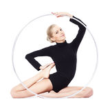 Blonde gymnast with hula hoop Stock Photo