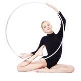Blonde gymnast with hula hoop Stock Photo