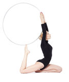 Blonde gymnast with hula hoop Stock Photos
