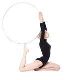 Blonde gymnast with hula hoop Stock Photos