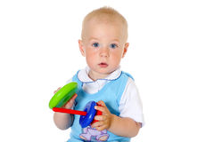 Blonde hair baby boy holds toy close-up portrait Royalty Free Stock Images