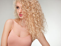 Blonde Hair. Beautiful Woman with Curly Long Hair. Royalty Free Stock Images