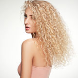 Blonde Hair. Beautiful Woman with Curly Long Hair. High quality Royalty Free Stock Images