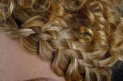 Blonde hair braided in a  braid Royalty Free Stock Images