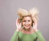 Blonde Hair Flying Between Hands Royalty Free Stock Images
