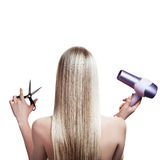 Blonde hair and hairdresser's tools Royalty Free Stock Photography
