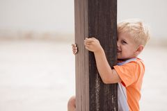 Kid smiles and play on terrace royalty free stock images