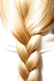 Blonde hair plaits. Long blond braid of thick hair Royalty Free Stock Image
