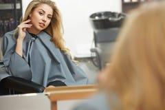 Blonde hair. Woman in hair salon Stock Image