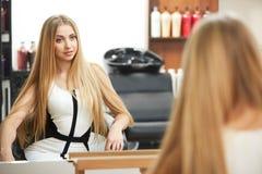 Blonde hair. Woman in hair salon Royalty Free Stock Photo