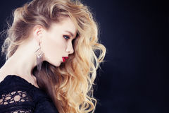 Blonde Hair Woman with Long Curly Royalty Free Stock Images