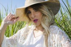 Blonde Hair Woman Wearing Brown Hat stock photo