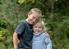 Blonde blue eyed siblings Royalty Free Stock Photos