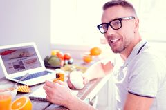 Blonde-haired man wearing glasses taking food supplements sitting on diet. Diet with supplements. Blonde-haired man wearing glasses taking food supplements stock photos