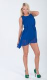 Blonde haired model in frilly blue dress Royalty Free Stock Photos