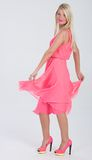 Blonde haired model in frilly pink dress Stock Photography