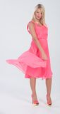 Blonde haired model in frilly pink dress Stock Photo
