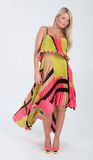Blonde haired model in multi colored dress Stock Image
