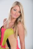 Blonde haired model in multi colored dress Stock Photo