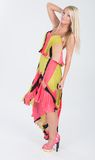 Blonde haired model in multi colored dress Royalty Free Stock Photo