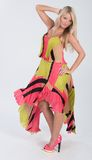Blonde haired model in multi colored dress Royalty Free Stock Images