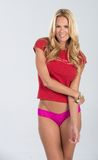 Blonde haired model in red and pink Royalty Free Stock Photography