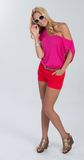 Blonde haired model in red and pink Royalty Free Stock Photo