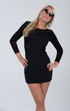Blonde haired model in short dress Royalty Free Stock Photo