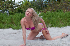 Blonde haired woman at a Florida beach. Royalty Free Stock Images