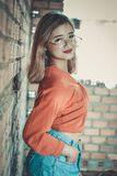 Blonde Haired Woman in Orange Long-sleeved Crop Top Wearing Round Gray Eyeglasses Royalty Free Stock Images