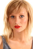 Blonde Haired Young Temptress. High-key photograph of an attractive blonde haired young woman Stock Image
