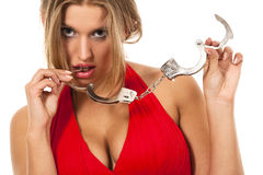 Blonde with handcuffs Royalty Free Stock Photos