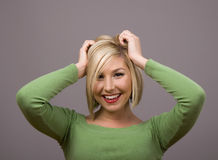 Blonde Hands in Hair Royalty Free Stock Images