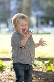 Blonde Happy Child playing in the Park Stock Images