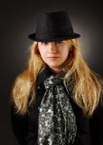 Blonde in hat. Blonde woman in a hat on a black background Stock Photos