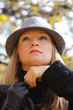 Blonde in hat adjusting sweater Royalty Free Stock Photos