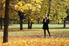 Blonde in hat in the autumn park Royalty Free Stock Photos