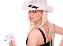 Blonde with hat holding poker of aces Stock Images