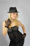 Blonde in hat in retro stiletto Stock Photography