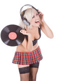Blonde in headphones with vinyl record Stock Photos