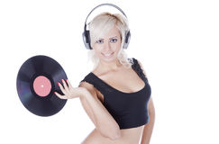 Blonde in headphones with vinyl record Royalty Free Stock Photography