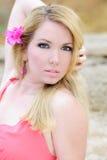 Blonde hermoso en vestido color de rosa Fotografía de archivo libre de regalías