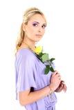 Blonde hermoso joven con la flor Imagen de archivo