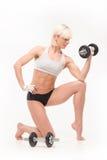 Blonde hermoso joven con una figura atlética Imagenes de archivo