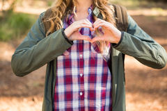 Blonde hiker framing heart with hands Stock Photography