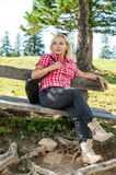 Blonde hiker take a rest royalty free stock images
