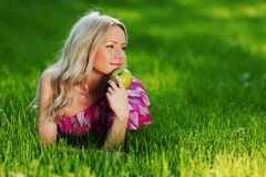 Blonde on green grass Royalty Free Stock Photos