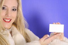 Blonde holding blank business card Royalty Free Stock Photo