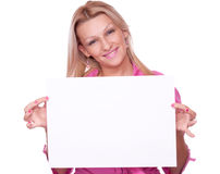 Blonde holding blank paper Stock Photos